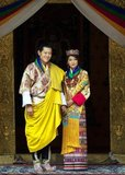 King Khesar (pronounced Gesar) is the eldest son of the fourth and previous Dragon King of Bhutan, Jigme Singye Wangchuck, and his father's third wife, Queen (Ashi) Tshering Yangdon.<br/><br/>  After completing his higher secondary studies from Yangchenphu Higher secondary school, Bhutan, Khesar studied abroad at Phillips Academy (Andover, Massachusetts), Cushing Academy and Wheaton College in Massachusetts, United States, before graduating from Magdalen College, University of Oxford, United Kingdom, where he completed the Foreign Service Programme and International Relations.<br/><br/>  In December 2005, King Jigme Singye Wangchuck announced his intention to abdicate in his son's favour in 2008, and that he would begin handing over responsibility to him immediately. On 14 December 2006, the king abdicated and transferred the throne to Jigme Khesar Namgyel Wangchuck who was officially crowned on 6 November 2008.<br/><br/>  Ashi Jetsun Pema Wangchuck (born 4 June 1990) is the Queen Consort (Druk Gyal-tsuen, literally 'Dragon Queen') of Bhutan, as the wife of King Jigme Khesar Namgyel Wangchuck.